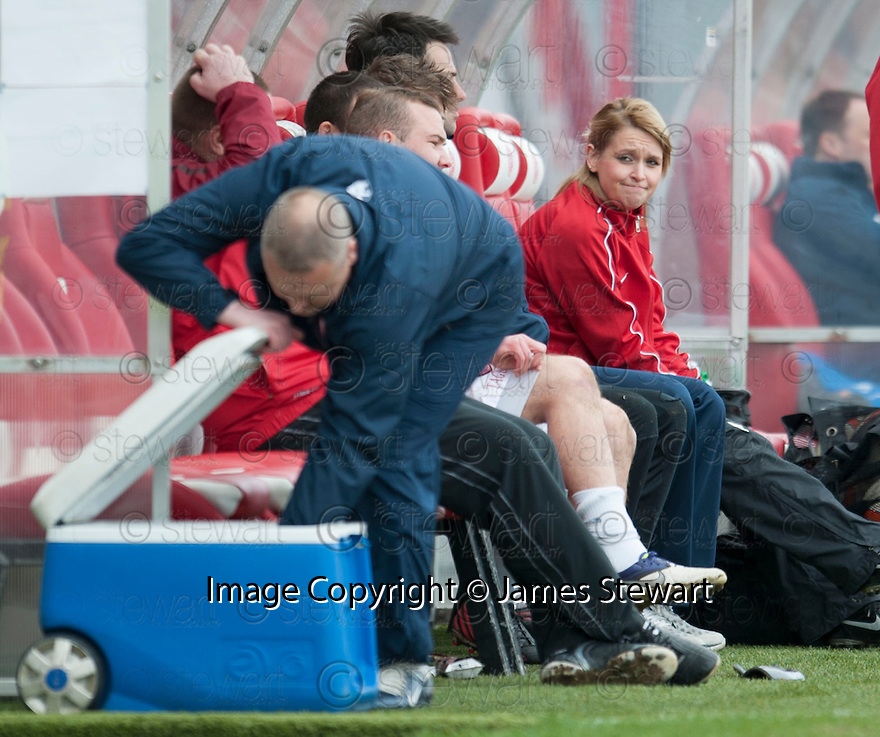 Accies Physiotherapist,  Sarah Boyd, seems to be not too sure of the view as Hamilton co-care taker manager Frankie McAvoy gets himself a drink.