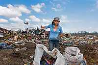In Granada, Nicaragua, these single women who are widowed or abandoned by their husbands are left to care for their children on their own. As a means to support their families they gather recycling in massive this massive garbage dump in for $1.00 a day.