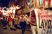 Demonstration in the Zocalo in support of EZLN (Ejercito Zapatista de Liberacion Nacional), the Zapatista agrarian reform movement. Marchers at night with banner La Voz. Mexico City Mexico D.F. Mexico.