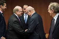 (L-R) Eurogroup President Dutch Finance Minister Jeroen Dijsselbloem, Irish Finance Minister Michael Noonan, Cypriot Finance Minister Harris Georgiades , French Foreign Minister Michel Sapin and Pier Carlo Padoan, Italian Minister for Economy and Finances    at the start of a Eurogroup with European Finance Ministers meeting at EU council headquarters in Brussels, Belgium on 26.01.2015 The Eurogroup's meeting focus on Greece, after  leftist anti-bailout party SYRIZA won parliamentary elections by Wiktor Dabkowski