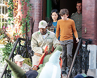 September 24, 2021.Winslow Fegley, Constance Wu, Extra dress as NYC Wildlife officers filming on location for  Sony pictures Lyle Lyle Crocodile<br />   with a stuff crocodile as special effects shot for post in New York September 24, 2021 Credit:RW/MediaPunch