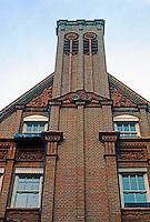 London: Mayfair. Red brick and terra cotta facade.