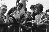 Street kids begging and/or selling newspaper and vegetables while drives stop on the traffic lightsg  in Bogota, Colombia  - Child labor as seen around the world between 1979 and 1980 – Photographer Jean Pierre Laffont, touched by the suffering of child workers, chronicled their plight in 12 countries over the course of one year.  Laffont was awarded The World Press Award and Madeline Ross Award among many others for his work.