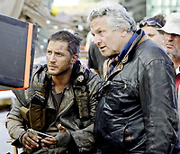 """NEW PICTURES TOM HARDY IN MAD MAX FURY ROAD MOVIE <br /> <br /> From director George Miller, originator of the post-apocalyptic genre and mastermind behind the legendary """"Mad Max"""" franchise, comes """"Mad Max: Fury Road,"""" a return to the world of the Road Warrior, Max Rockatansky.<br /> <br /> Haunted by his turbulent past, Mad Max believes the best way to survive is to wander alone. Nevertheless, he becomes swept up with a group fleeing across the Wasteland in a War Rig driven by an elite Imperator, Furiosa. They are escaping a Citadel tyrannized by the Immortan Joe, from whom something irreplaceable has been taken. Enraged, the Warlord marshals all his gangs and pursues the rebels ruthlessly in the high-octane Road War that follows.<br /> <br /> Tom Hardy (""""The Dark Knight Rises"""") stars in the title role in """"Mad Max: Fury Road""""—the fourth in the franchise's history. Oscar winner Charlize Theron (""""Monster,"""" """"Prometheus"""") stars as the Imperator, Furiosa. The film also stars Nicholas Hoult (""""X-Men: Days of Future Past"""") as Nux; Hugh Keays-Byrne (""""Mad Max,"""" """"Sleeping Beauty"""") as Immortan Joe; and Nathan Jones (""""Conan the Barbarian"""") as Rictus Erectus. Collectively known as The Wives, Zoë Kravitz (""""Divergent"""") plays Toast, Riley Keough (""""Magic Mike"""") is Capable, Rosie Huntington-Whiteley (""""Transformers: Dark of the Moon"""") is Splendid, and supermodel Abbey Lee is The Dag, and Courtney Eaton is Fragile. Also featured in the movie are Josh Helman as Slit, Jennifer Hagan as Miss Giddy, and singer/songwriter/performer iOTA as Coma-Doof Warrior.<br /> <br /> Picture shows Tom hardy discusses a scene with director George Miller<br /> 75596<br /> EDITORIAL USE ONLY"""