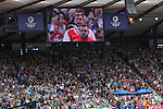 Glasgow 2014 Commonwealth Games<br /> Aled Davies (Wales) on the big screen as the anthem is played.<br /> Hampden Park<br /> 28.07.14<br /> ©Steve Pope-SPORTINGWALES