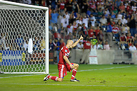 Chicago midfielder Freddie Ljungberg (8) gives a thumbs up to teammate Brian McBride (20) for a good pass.  The Chicago Fire tied the New York Red Bulls 0-0 at Toyota Park in Bridgeview, IL on August 8, 2010