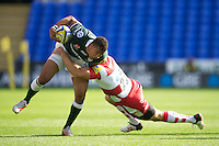 Anthony Watson of London Irish is tackled by Mike Tindall of Gloucester Rugby during the Aviva Premiership match between London Irish and Gloucester Rugby at the Madejski Stadium on Saturday 8th September 2012 (Photo by Rob Munro)