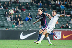 Auckland City Midfielder Clayton Lewis (r) attempts a kick during the Nike Lunar New Year Cup 2017 match between SC Kitchee (HKG) and Auckland City FC (NZL) on January 31, 2017 in Hong Kong, Hong Kong. Photo by Marcio Rodrigo Machado / Power Sport Images