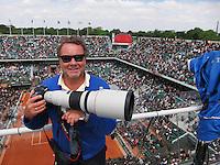 03-06-13, Tennis, France, Paris, Roland Garros,  Photographer Henk Koster on top of court Philippe Chatrier (Centercourt)