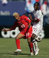 July 24, 2005: East Rutherford, NJ, USA:  USMNT forward DaMarcus Beasley (7) and Julio Medina III (10) of Panama collide during the CONCACAF Gold Cup Finals at Giants Stadium.