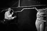 Wally Shufflebottom. Knife throwing strip tease fairground act. <br /> <br /> The Derby Horse Race Epsom Downs. Surrey England 1969