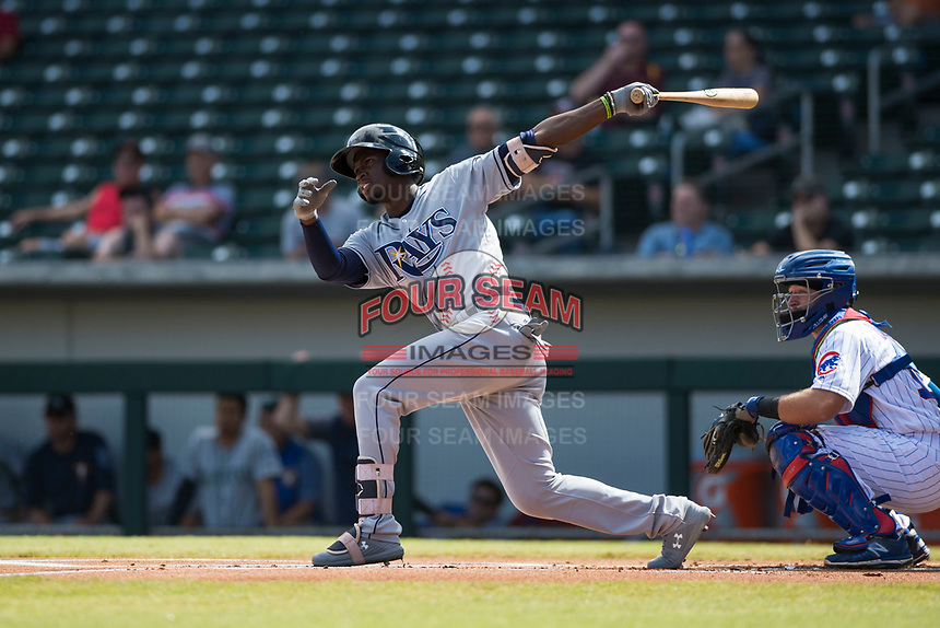 Peoria Javelinas shortstop Lucius Fox (5), of the Tampa Bay Rays organization, follows through on his swing in front of P.J. Higgins (12) during an Arizona Fall League game against the Mesa Solar Sox at Sloan Park on October 11, 2018 in Mesa, Arizona. Mesa defeated Peoria 10-9. (Zachary Lucy/Four Seam Images)