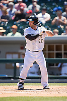 George Kottaras (20) of the Charlotte Knights at bat against the Indianapolis Indians at BB&T BallPark on June 21, 2015 in Charlotte, North Carolina.  The Knights defeated the Indians 13-1.  (Brian Westerholt/Four Seam Images)