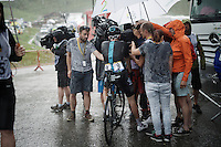 Geraint Thomas (GBR/SKY) being interviewed during a thunderstorm immediately after finishing stage 9 in Andorra Arcalis (coming from Velha Val d'Aran/ESP, 184km)<br /> <br /> 103rd Tour de France 2016