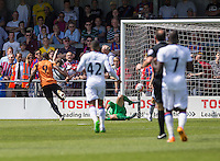 John Akinde of Barnet scores the opening goal against Crystal Palace during the Friendly match between Barnet and Crystal Palace at The Hive, London, England on 11 July 2015. Photo by David Horn.