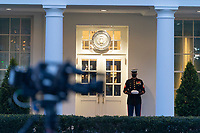 A Marine guard stands watch at the West Wing of the White House in Washington, DC, January 13, 2021 after the U.S. House of Representatives voted to impeach U.S. President Donald Trump. Credit: Chris Kleponis / Pool via CNP /MediaPunch