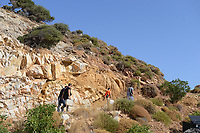 Pictured: Emergency services personnel walk to the area where the body was discovered in Ikaria, Greece. Thursday 08 August 2019<br /> Re: Rescuers searching for  British scientist Natalie Christopher, 35, who disappeared on the  island of Ikaria, Greece have found her body at the bottom of a ravine.<br /> She was found less than a mile from the hotel in the Kerame area where she was on holiday with her Cypriot partner.<br /> Emergency service staff said that a large rock had dislodged as she fell, causing multiple head injuries.<br /> The woman's body will be kept overnight at the spot so a coroner can examine it on Thursday morning.