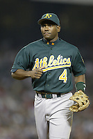 Miguel Tejada of the Oakland Athletics during a 2002 MLB season game against the Los Angeles Angels at Angel Stadium, in Anaheim, California. (Larry Goren/Four Seam Images)