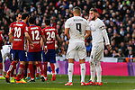 Real Madrid´s Sergio Ramos talk to Karim Benzema during 2015/16 La Liga match between Real Madrid and Atletico de Madrid at Santiago Bernabeu stadium in Madrid, Spain. February 27, 2016. (ALTERPHOTOS/Victor Blanco)