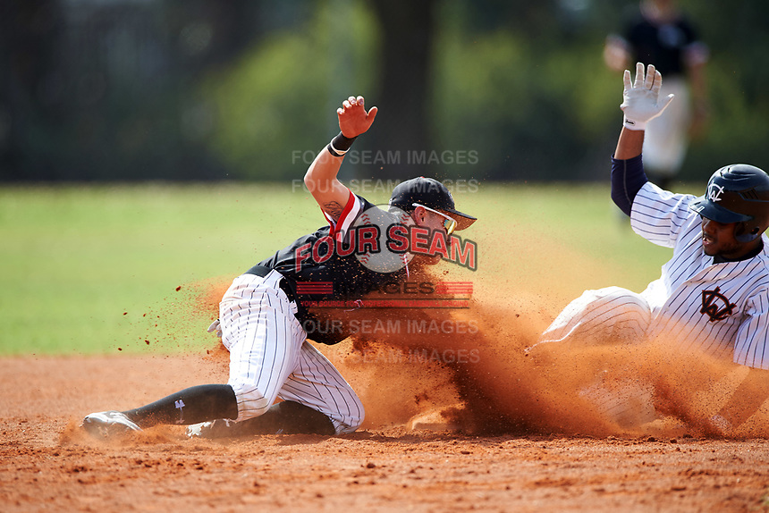 Edgewood College Eagles Peter Perales (7) attempts to tag Stanley Rijo (1) stealing second base during the second game of a doubleheader against Western Connecticut Colonials on March 13, 2017 at the Lee County Player Development Complex in Fort Myers, Florida.  Edgewood defeated Western Connecticut 2-1.  (Mike Janes/Four Seam Images)