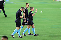 NASHVILLE, TN - SEPTEMBER 23: Referee Tori Penso walks the field with assistant referees Logan Brown and Jeremy Hanson before a game between D.C. United and Nashville SC at Nissan Stadium on September 23, 2020 in Nashville, Tennessee.