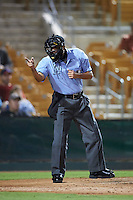 Umpire Alex Ortiz makes a call during an Arizona Fall League game between the Salt River Rafters and Glendale Desert Dogs on October 21, 2015 at Camelback Ranch in Glendale, Arizona.  Glendale defeated Salt River 1-0.  (Mike Janes/Four Seam Images)