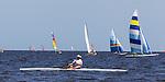 Boats sail and row off the beach at Shell Point Regatta during the 40th Annual Stephen C Smith Regatta April 27, 2013.<br /> ©2013 Mark Wallheiser