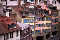 AJ1963, Switzerland, Lausanne, Vaud, Europe, Pastel colored buildings along the street in downtown Lausanne in the Canton of Vaud.
