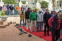 South Africa, Cape Town.  Men Praying at Friday Prayers at the Al-Azhar Mosque.