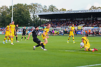 9th October 2021;  VBS Community Stadium, Sutton, London; EFL League 2 football, Sutton United versus Port Vale; Louis John (6) of Sutton United diving to use his whole body to block a shot by David Worrall (7) of Port Vale.