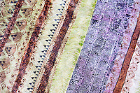 A close-up view of tapa (or kapa) cloth after it has been dyed and completed, by artist Roen Hufford, Big Island. The wauke (or paper mulberry) bark that becomes cloth and the Hawaiian plants that the dyes are made from are all grown on her family's land.