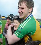 Cillian Roughan of Inagh-Kilnamona celebrates with fan Christina Davenport  following the Minor A county final win over Kilmaley at Cusack Park. Photograph by John Kelly.
