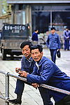 Men Leaning On Railing