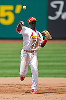 Jermaine Curtis (22) of the Springfield Cardinals throws to first base during a game against the Arkansas Travelers at Hammons Field on May 8, 2012 in Springfield, Missouri. (David Welker/ Four Seam Images).