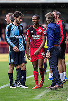 Joe Jacobson of Wycombe Wanderers and Lewis Young of Crawley Town share a laugh with Gareth Ainsworth Manager of Wycombe Wanderers during the Sky Bet League 2 match between Crawley Town and Wycombe Wanderers at Checkatrade.com Stadium, Crawley, England on 29 August 2015. Photo by Liam McAvoy.