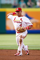 Kolten Wong (4) of the Springfield Cardinals throws to first base during a game against the Arkansas Travelers at Hammons Field on June 12, 2012 in Springfield, Missouri. (David Welker/Four Seam Images).