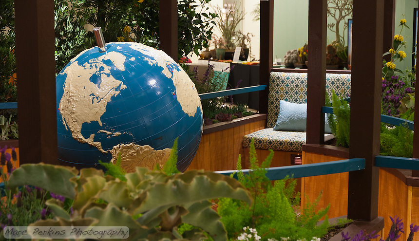 "A view of the braille world globe and one of the garden benches of Orange Coast College's Ornamental Horticulture Club's first-place winning garden installation at the 2012 South Coast Plaza Spring Garden Show in Costa Mesa, CA.  The theme for the show was ""healing gardens"", and the OCC team installed a ""garden for the visually impaired.""  The garden's centerpiece is a 1957 restored globe for the blind, with the world geography in exaggerated height to be sensed by the touch of blind people; the locations of plants in the garden was indicated in braille on the globe."