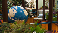 """A view of the braille world globe and one of the garden benches of Orange Coast College's Ornamental Horticulture Club's first-place winning garden installation at the 2012 South Coast Plaza Spring Garden Show in Costa Mesa, CA.  The theme for the show was """"healing gardens"""", and the OCC team installed a """"garden for the visually impaired.""""  The garden's centerpiece is a 1957 restored globe for the blind, with the world geography in exaggerated height to be sensed by the touch of blind people; the locations of plants in the garden was indicated in braille on the globe."""