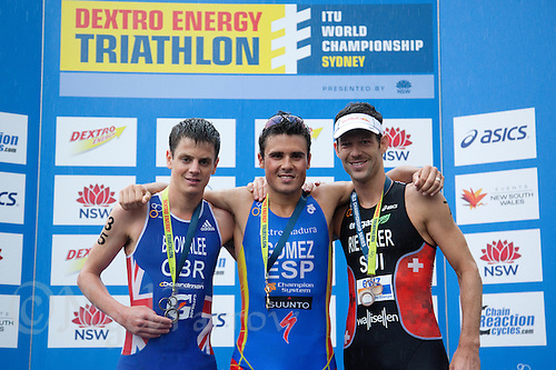 10 APR 2011 - SYDNEY, AUS - Javier Gomez (centre) poses for pictures with runner up Jonathan Brownlee (left) and third place finisher Sven Riederer (right) after winning the men's ITU World Championship Series triathlon in Sydney, Australia .(PHOTO (C) NIGEL FARROW)