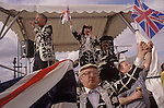 The Derby Horse race Epsom Downs Surrey Uk. Pearly Kings and Queens sing around the Band Stands at the end of the days racing.  1980s