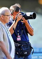 23 July 2011: Los Angeles Dodgers Team Photographer Jon SooHoo (right) tries out a rare Nikkor 500mm f/5 Mirror lens prior to a game against the Washington Nationals at Dodger Stadium in Los Angeles, California. The Dodgers rallied to defeat the Nationals 7-6 on a Rafael Furcal walk-off, RBI double in the bottom of the 9th inning. Mandatory Credit: Ed Wolfstein Photo