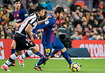 Lionel Andres Messi (R) of FC Barcelona is tackled by Ivan Lopez Alvarez, Ivi, of Levante UD  during the La Liga 2017-18 match between FC Barcelona and Levante UD at Camp Nou on 07 January 2018 in Barcelona, Spain. Photo by Vicens Gimenez / Power Sport Images