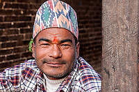 Bhaktapur, Nepal.  Newari Man with Bindi, Wearing a Traditional Hat (Topi).