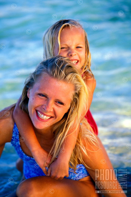 Mother and daughter at the ocean in Hawaii