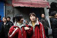 CHINA. Shanghai. Students outside a school in the old town. Shanghai is a sprawling metropolis or 15 million people situated in south-east China. It is regarded as the country's showcase in development and modernity in modern China. This rapid development and modernization, never seen before on such a scale has however spawned countless environmental and social problems. 2008.