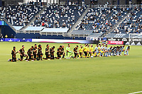 KANSAS CITY, UNITED STATES - AUGUST 25: Houston Dynamo and Sporting KC players take a pre kick off kneel  a game between Houston Dynamo and Sporting Kansas City at Children's Mercy Park on August 25, 2020 in Kansas City, Kansas.