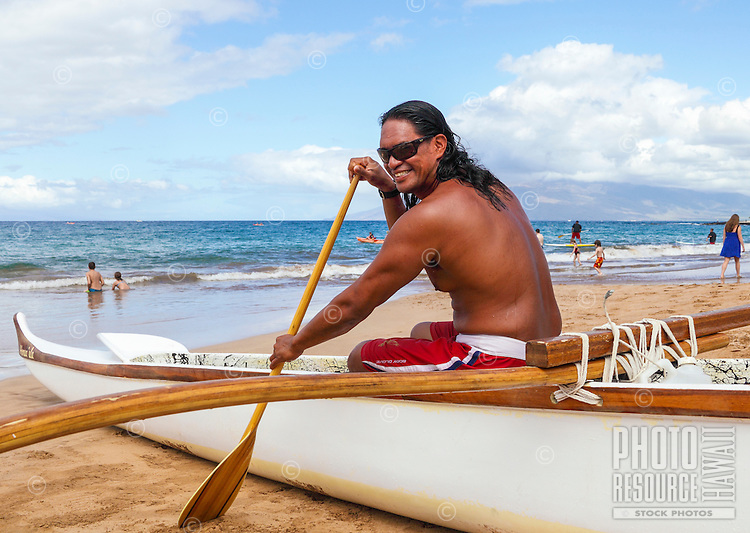 An outrigger canoe guide at Wailea Beach, Maui. (Note: He is model released, but not the others in the background.)
