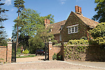 Grantchester Cambridgeshire, UK. The Old Vicarage home of Jeffrey Archer and once the home of the English poet Rupert Brooke, who statue now stands in the front drive.