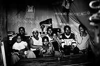 The Odongo Family live in a small mud house in Kibera. From left to right: Augustin Odongo with Michelle, Clarissa Adiambo, Cynthia, Lavenda, Naomi, Meshak and Eunice. Over 25 percent of Nairobi's population live in Kibera, an area that covers less than one percent of the city. Although the population of the slum is over one million, it is recognised officially as a 'squat', or illegally occupied land, which allows the government to ignore the basic needs of the inhabitants.