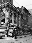 Pittsburgh PA:  View of the corner of Wood Street and Diamond Street.  Nearby stores include; Dimling's Candy, Ellis Billiards, Rosenthal Dentist, and W.T. Grants